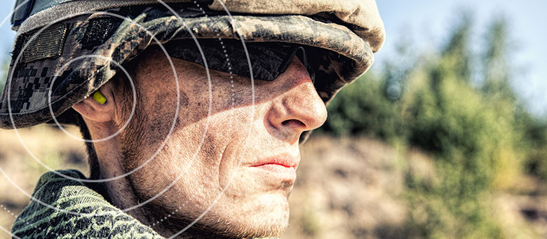 Soldier with earplugs